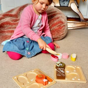 Girl child playing with Play Food Set