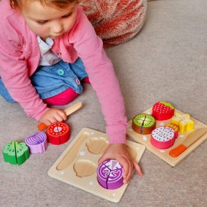 Toddler Playing with Fruit Vegetable Set