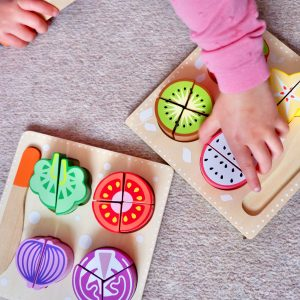 Kid Playing with Wooden Fruit Playset