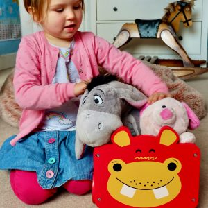 Girl playing with Pull Along Toy Storage Box