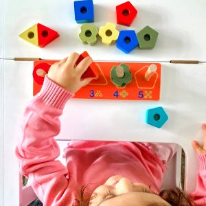 Child Playing with Wooden Geometric Toy