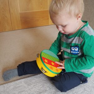 Kid Playing with STAR design Wooden Tamboutine