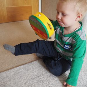 Boy Playing with Wooden Musical Tambourine Toy