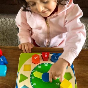 Kid playing with Teaching Clock Toy