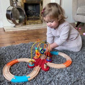 Girl playing with Railway Train Set Toy