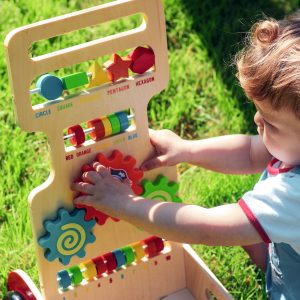 Kid Playing with Activity Walker Fire Engine