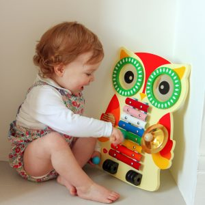 Toddler Playing with Wooden Musical toy