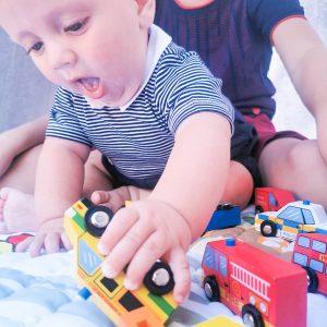Toddler playing Wooden Car set