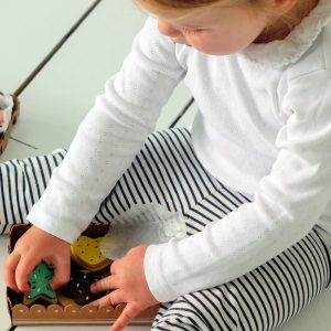 Kid playing with wooden biscuits toys